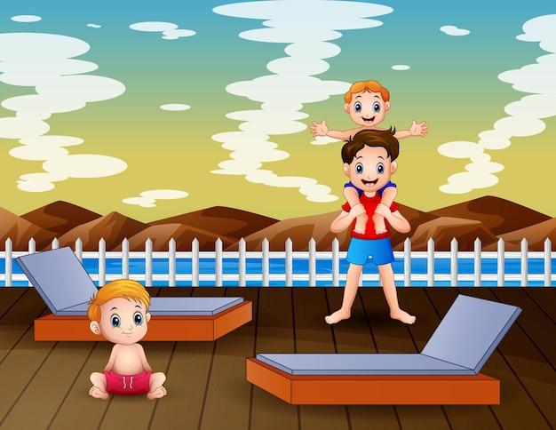 Eine tropische landschaft mit den jungs, die auf dem pier spielen