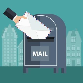 Einen umschlag in eine mailbox legen