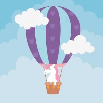 Einhorn, das niedliche cartoonillustration des heißluftballonphantasie-magietraums fliegt