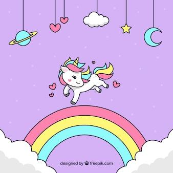 Einhorn hintergrund mit hand gezeichnet regenbogen
