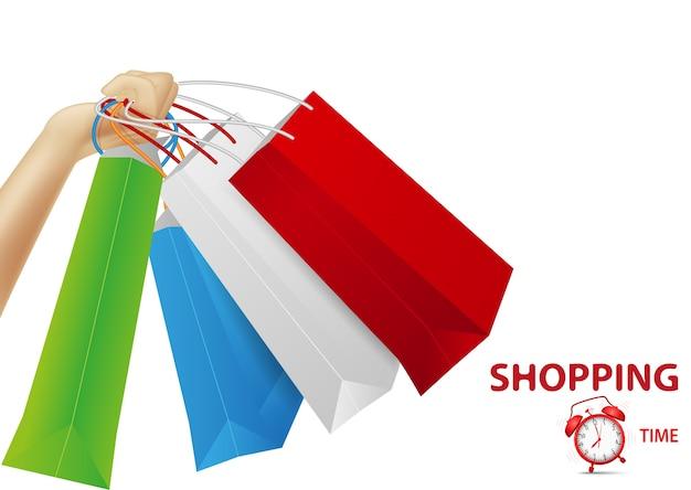 Einkaufskonzepthintergrund, hand, die taschen hält