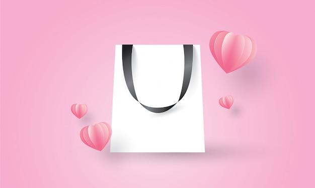 Einkaufstasche auf rosa hintergrund