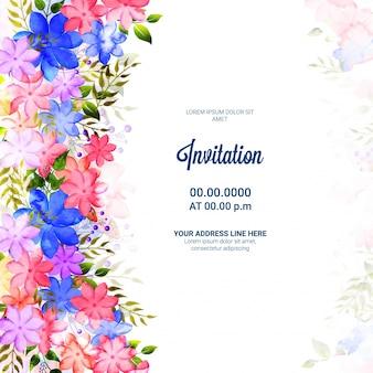 Einladungskarte mit bunten blumen und grünen blättern.
