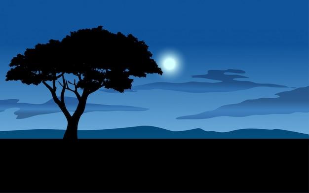 Einsamer baum in schöner nacht