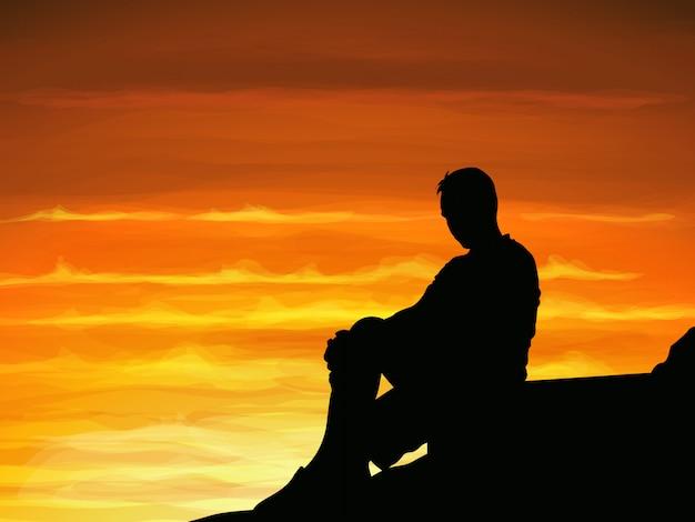 Einsamer mann des schattenbildes, der alleine wenn dämmerung sitzt.