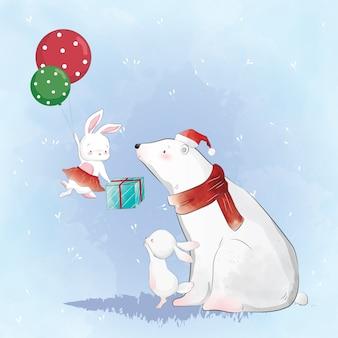 Eisbär und das häschen, das ein weihnachtsgeschenk empfängt