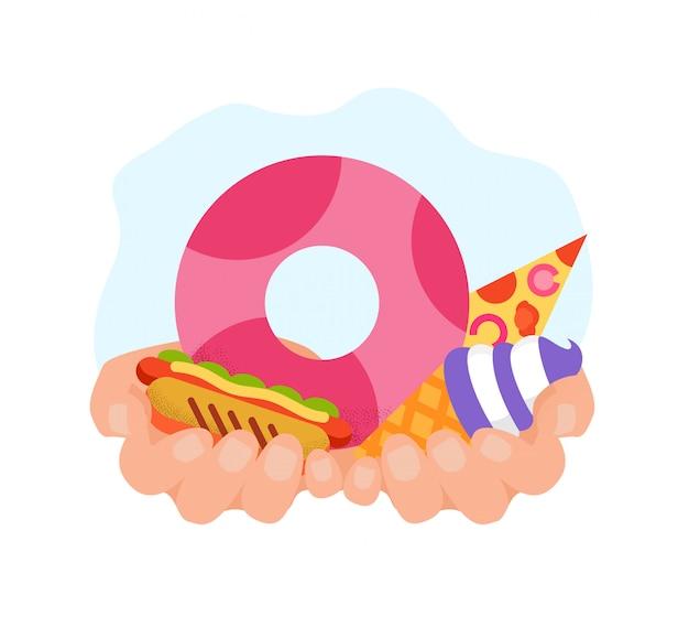 Eiscreme-donut und hotdog in der hand. kalorienreiches essen.