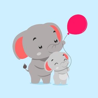 Elefant und elefantenbaby spielen zusammen mit rotem ballon