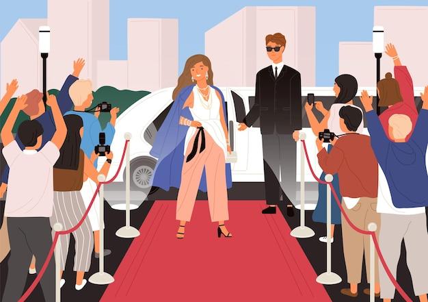 Elegante junge schöne frau, weibliche berühmtheit, filmstar oder superstar posiert vor fotografen während der zeremonie auf dem roten teppich
