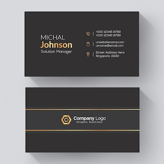 Elegante unternehmenskarte mit goldenen und grauen details
