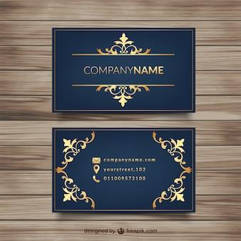 Elegante visitenkarte mit goldenen verzierungen