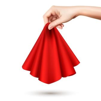 Elegante weibliche hand, die rundes drapiertes seidentuch der roten seide erhebt, das es realistisches bild der mitte hält