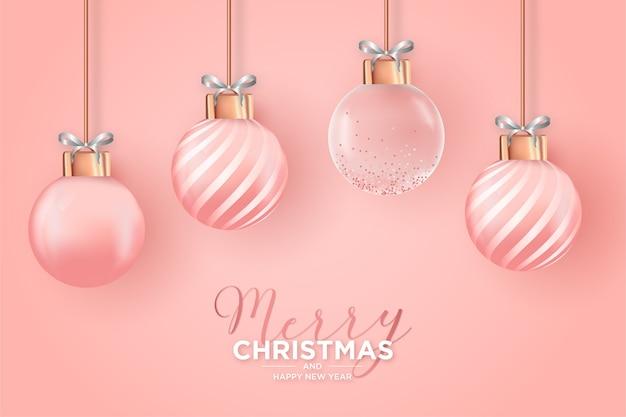 Elegante weihnachtskarte mit realistischen rosa weihnachtskugeln