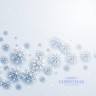Eleganten weißen hintergrund mit fließenden schneeflocken frohe weihnachten wintern gruß
