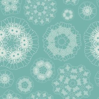 Elegantes geometrisches nahtloses blumenmuster auf blauem hintergrund