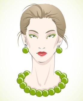 Elegantes junges vorbildliches porträt mit grünen perlen