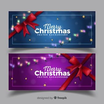 Elegantes weihnachtsfahnenset mit heller girlande