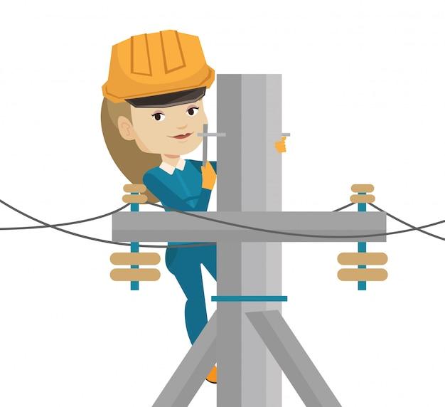 Elektriker arbeitet am strommast.