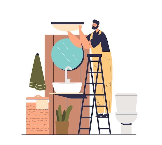 Elektriker, der im badezimmer arbeitet, das neue lampe installiert