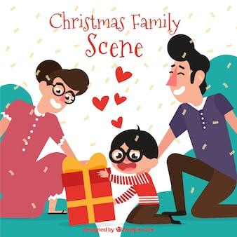 Eltern geben ihrem sohn ein weihnachtsgeschenk