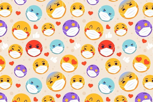Emoji mit gesichtsmaskenmuster Premium Vektoren