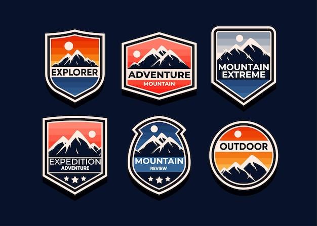 Entdecken sie mountain adventure symbolsatz