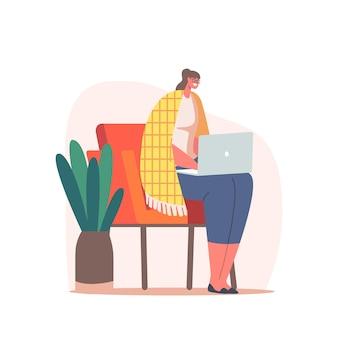 Entspannte geschäftsfrau oder freiberuflerin, die am laptop sitzt und auf einem mit gemütlichem plaid bedeckten stuhl sitzt. freiberuflicher mitarbeiter