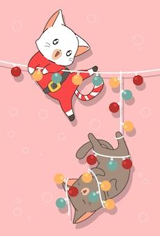 Entzückende katzen mit licht am weihnachtstag