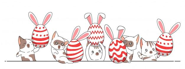 Entzückende katzen und eier am ostertag