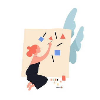 Entzückende niedliche lesekopffrau, die abstrakte geometrische formen auf leinwand malt.