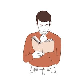 Entzückender nachdenklicher junger mann, der buch liest oder sich auf prüfung vorbereitet.