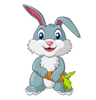 Entzückendes kaninchen, das karottenkarikatur hält