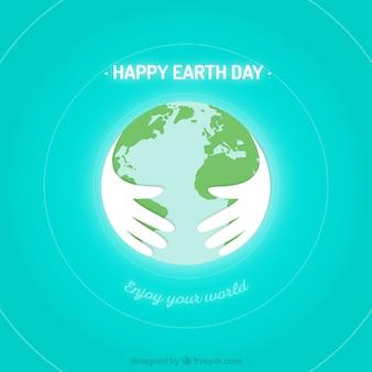Erde mit den händen geschützt