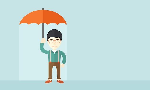 Erfolgreicher mann mit regenschirm.