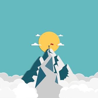 Erfolgsgeschäftsmann steht oben auf dem berg