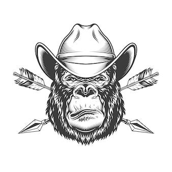 Ernster gorillakopf im cowboyhut