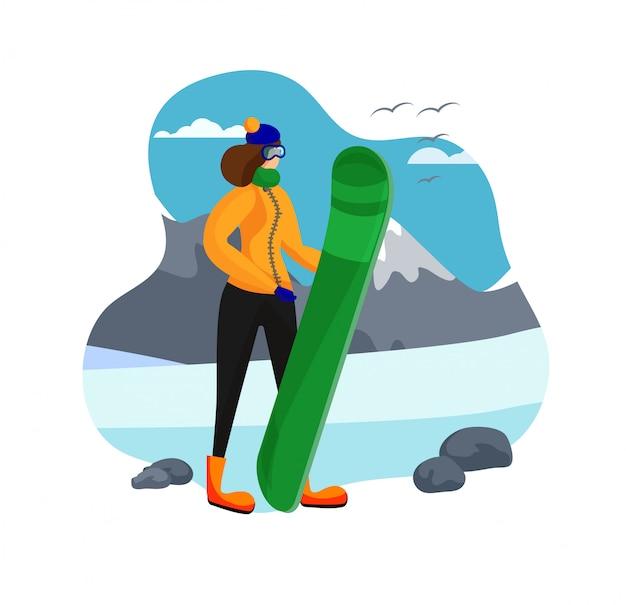Erwachsene frau in der winter-kleidung, die snowboard hält