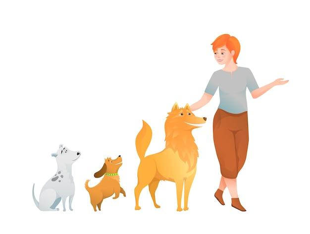 Erwachsene junge frau, die sich um drei gehende, streichelnde, liebende hunde kümmert. isoliert auf weiß.