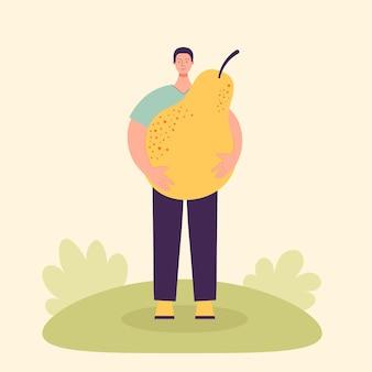 Erwachsener männlicher bauer mit einer großen birne erntekonzept vegetarismus gesunde ernährung