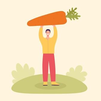 Erwachsener männlicher bauer mit einer großen karotte erntekonzept vegetarismus gesunde ernährung