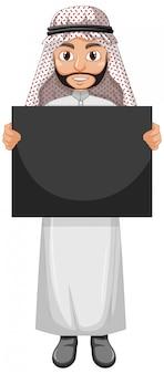 Erwachsener mann arabisch, der arabisches kostüm trägt und leeres plakat oder plakat hält