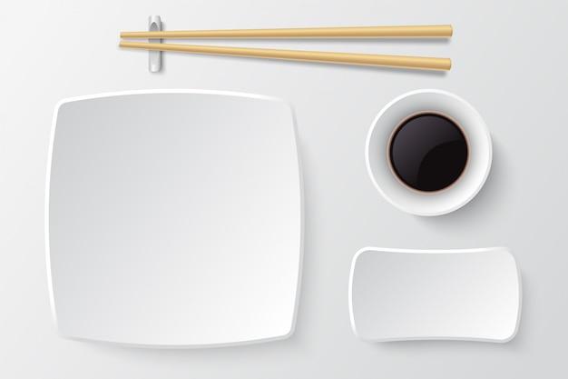 Essstäbchen und leere sushiplatte. asiatische restaurantgerichte