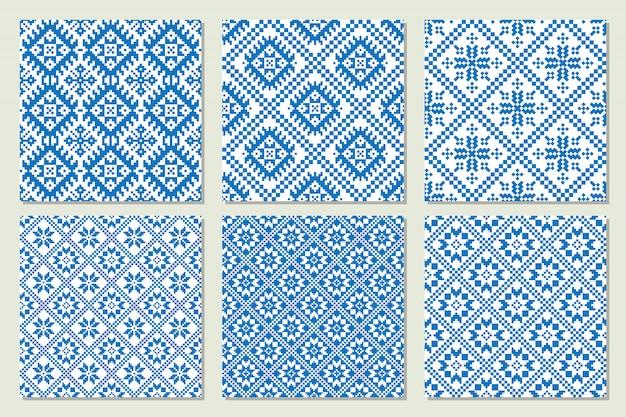 Ethnische nordische muster stellten ansammlung in den blauen und weißen farben ein. vektor-illustration