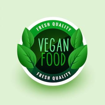 Etikett oder aufkleber der grünen blätter des veganen essens