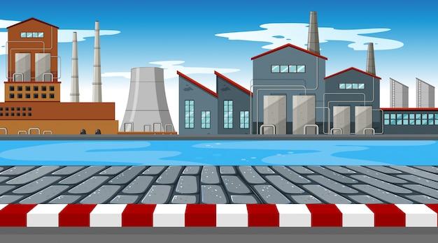 Fabrikszene mit fluss im vordergrund