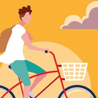 Fahrrad des jungen mannes reitmit himmelorange