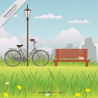 Fahrrad in der nähe der bank in einem park hintergrund