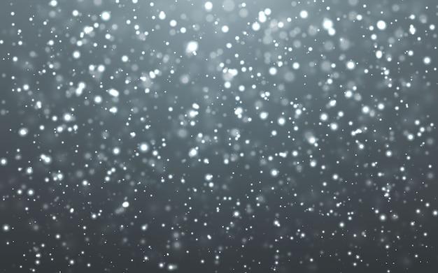 Fallende schneeflocken auf dunklem hintergrund