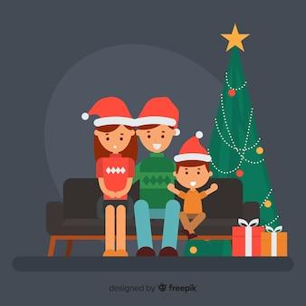 Familie auf der sofaweihnachtsillustration