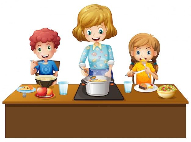 Familie, die mahlzeit am tisch hat
